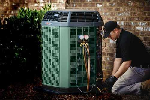 Repair or replace air conditioning system Centeral Air Conditioning Atlantis technician servicing unit for Regular AC Service